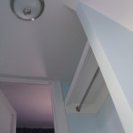 Basement stairway 2011: Ceiling and coat/shelf nook to kitchen finished.